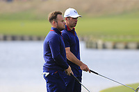 Tyrrell Hatton and Paul Casey Team Europe on the 18th green during Friday's Fourball Matches at the 2018 Ryder Cup, Le Golf National, Iles-de-France, France. 28/09/2018.<br /> Picture Eoin Clarke / Golffile.ie<br /> <br /> All photo usage must carry mandatory copyright credit (© Golffile | Eoin Clarke)