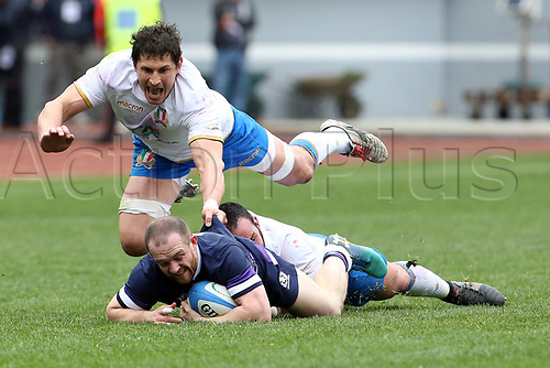 17th March 2018, Stadio Olimpico, Rome, Italy; NatWest Six Nations rugby, Italy versus Scotland; Sean Maitland (bottom front) of Scotland is challenged by Tommaso Castello (rear) and Alessandro Zanni (top) of Italy