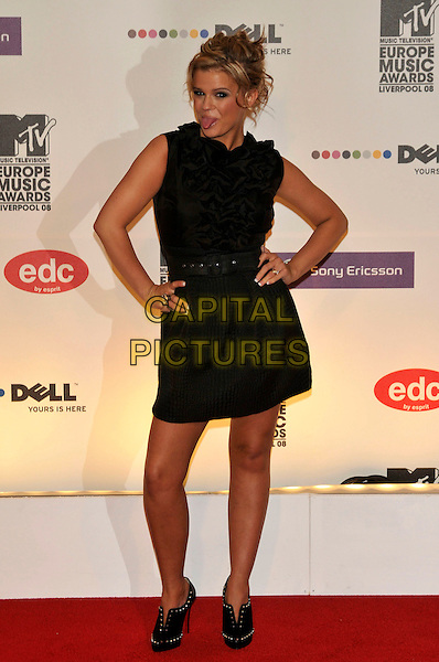 KERRY KATONA.2008 MTV Europe Music Awards arrivals at Echo Arena, Liverpool, England..6th November 2008.EMA full length black sleeveless dress ruffled ruffles hands on hips tongue ankle shoe boots .CAP/PL.©Phil Loftus/Capital Pictures.