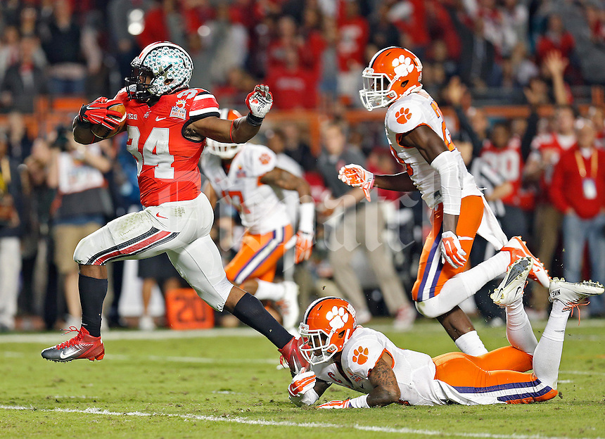 Ohio State Buckeyes running back Carlos Hyde (34) breaks free from Clemson Tigers cornerback Darius Robinson (8) for a run down to the 1 yard line during the 3rd quarter in the Discover Orange Bowl at Sun Life Stadium in Miami Gardens, Florida on January 3, 2014.(Dispatch photo by Kyle Robertson)
