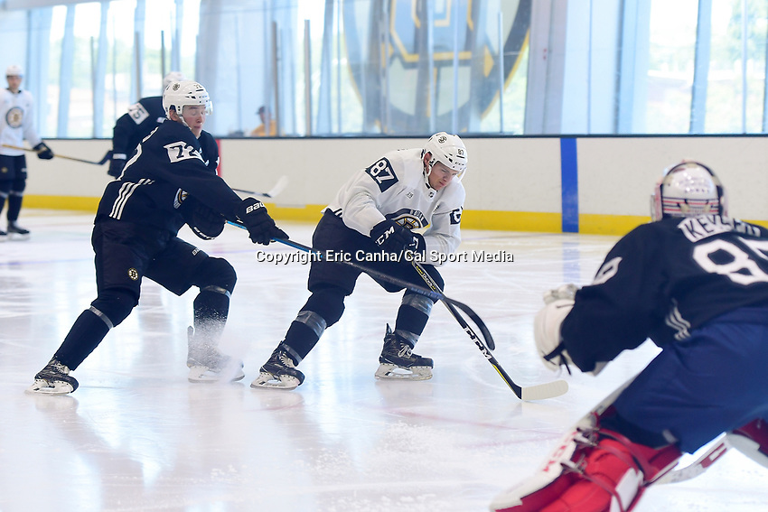 June 29, 2018: Boston Bruins forward Jack Becker (72) stick checks defenseman Philip Beaulieu (87) during a scrimmage at the Boston Bruins development camp held at Warrior Ice Arena in Brighton Mass. Eric Canha/CSM