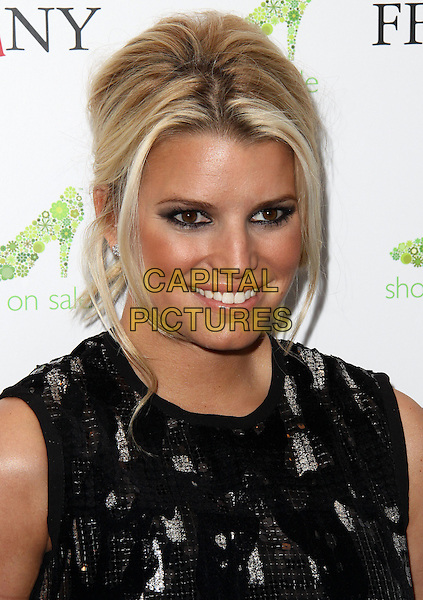 "JESSICA SIMPSON.16th Annual QVC Presents ""FFANY Shoes on Sale"" to benefit Breast Cancer Research and Education, New York, NY, USA, 13th September 2009..portrait headshot make-up tanned skin face black eyeshadow eyeliner smoky smokey eyes hair up bronzer smiling sleeveless .CAP/ADM/PZ.©Paul Zimmerman/AdMedia/Capital Pictures."