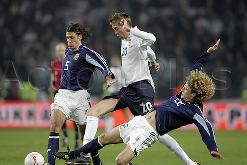 12 November 2005: England striker Peter Crouch is tackled by Martin Demichelis (5) and Fabricio Coloccini (22) during the International Friendly between England and Argentina played at the Stade de Geneve, Geneva, Switzerland. England won the game 3-2. Photo: Neil Tingle/Actionplus..051112 football soccer player