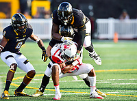 Baltimore, MD - OCT 14, 2017: Towson Tigers linebacker Diondre Wallace (56) and Towson Tigers defensive back Mitch Boals (33) pile on Richmond Spiders wide receiver Dejon Brissett (18) during game between Towson and Richmond at Johnny Unitas Stadium in Baltimore, MD. The Spiders defeated the Tigers 23-3. (Photo by Phil Peters/Media Images International)