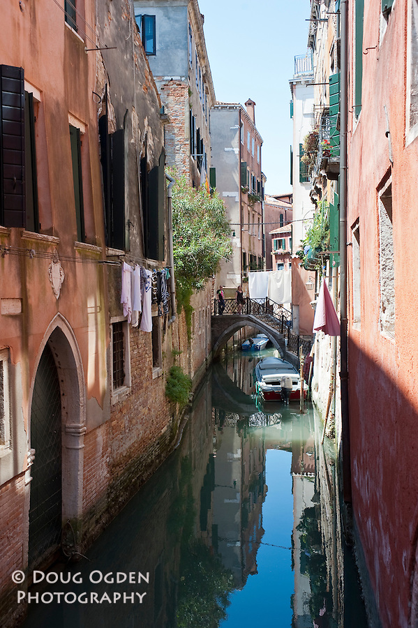 Reflections in a side canal, Venice, Italy