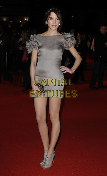 "CAROLINE SIEBER.""Remember Me"" UK Film Premiere - Arrivals held at Odeon cinema, Leicester Square, London, England..March 17th 2010 .full length greige beige mushroom taupe brown mink grey gray silk chiffon dress ruffles ruffle sleeve shoulders clutch bag hairband hair band platform patent shoes bare legs mini peep toe booties shooboots hand on hip.CAP/CAN.©Can Nguyen/Capital Pictures."