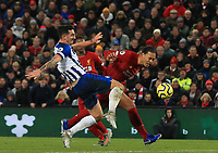 30th November 2019; Anfield, Liverpool, Merseyside, England; English Premier League Football, Liverpool versus Brighton and Hove Albion; Lewis Dunk of Brighton and Hove Albion makes a vital tackle to deny Virgil van Dijk of Liverpool a chance to complete his hat trick - Strictly Editorial Use Only. No use with unauthorized audio, video, data, fixture lists, club/league logos or 'live' services. Online in-match use limited to 120 images, no video emulation. No use in betting, games or single club/league/player publications