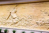 Nanjing, Jiangsu, China.  Wall Sculpture in the Usnisa Palace, Niushou Mountain.
