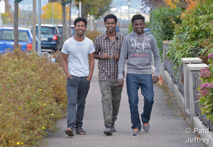Three asylum seekers from Eritrea--Luel Sium, Biniaya Tekle and Russom Mahari--walk along a street near a church-run shelter where they live in Freudenstadt, Germany. The Freundesdreis Asyl is run by Christlicher Kirchen, and managed by a retired United Methodist pastor. The shelter has 18 asylum seekers from Eritrea and 10 from Gambia. They came to Europe via Sudan and Libya, crossing the Mediterranean to Italy.