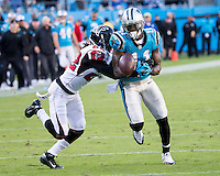The Carolina Panthers defeated the Atlanta Falcons 34-10 in an inter-division rivalry played in Charlotte, NC at Bank of America Stadium.  Carolina Panthers wide receiver Brandon LaFell (11), Atlanta Falcons cornerback Asante Samuel (22)