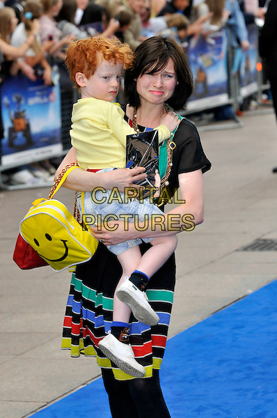 "SOPHIE ELLIS BEXTOR & son SONNY.UK Premiere of ""Wall-E"" at the Empire, Leicester Square, London, England. .July 13th, 2008.half 3/4 length holding child carrying kid mother family smiley face yellow backpack black striped skirt tights dress funny face sad .CAP/PL.©Phil Loftus/Capital Pictures."
