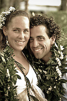 Young local couple touching foreheads at their wedding at Ke'iki Beach, North Shore