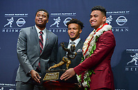 New York, NY - December 8, 2018:  Dwyane Haskins, Kyler Murray and Tua Tagovailoa pose with the Heisman Trophy after speaking to the media at the New York Marriott hotel December 8, 2018.  (Photo by Don Baxter/Media Images International)