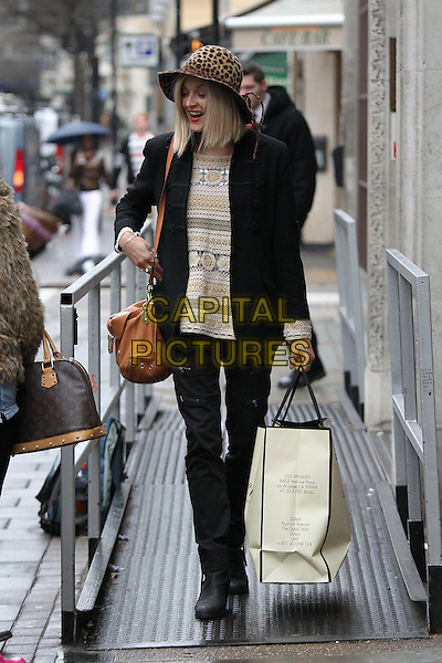 Fearne Cotton leaving the BBC Radio 1 studios, London, England..January 20th, 2011.full length black coat jacket trousers brown leopard print hat white cream beige top bag purse crochet.CAP/CAN.©Can Nguyen/Capital Pictures.