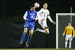 25 October 2013: Duke's Brody Huitema (CAN) (19) and Wake Forest's Jared Watts (2) challenge for a header. The Duke University Blue Devils hosted the Wake Forest University Demon Deacons at Koskinen Stadium in Durham, NC in a 2013 NCAA Division I Men's Soccer match. The game ended in a 2-2 tie after two overtimes.