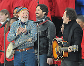 "Washington, DC - January 18, 2009 -- Pete Seeger, left, Bruce Springsteen, right, and Seeger's grandson Tao Seeger, center, after performing at the ""Today: We are One - The Obama Inaugural Celebration at the Lincoln Memorial"" in Washington, D.C. on Sunday, January 18, 2009..Credit: Ron Sachs / CNP.(RESTRICTION: NO New York or New Jersey Newspapers or newspapers within a 75 mile radius of New York City)"