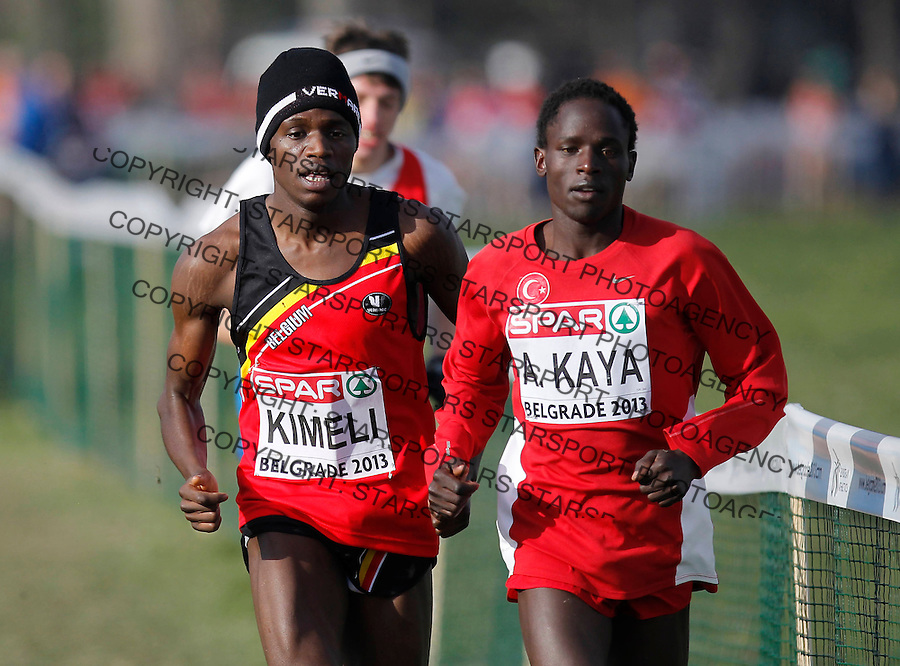 BELGRADE, SERBIA - DECEMBER 08: Ali Kaya (R) of Turkey and Isaac Kimeli (L) of Belgium competes in the Junior Men's race  during the 20th SPAR European Cross Country Championships on December 8, 2012 in Belgrade, Serbia. (Photo by Srdjan Stevanovic/Getty Images)