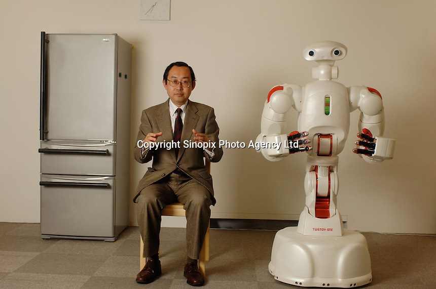 "Professor Shigeki Sugano, head of the Department of Modern Mechanical Engineering at Tokyo's Waseda University, poses next to Twendy One. The human symbiotic robot ""Twendy One"" that is being developed to aid in labor shortage and in aging societies. The 1.5 meter tall and 111 kg heavy robot is able to assist lift a human and also is dextrous enough to massage."