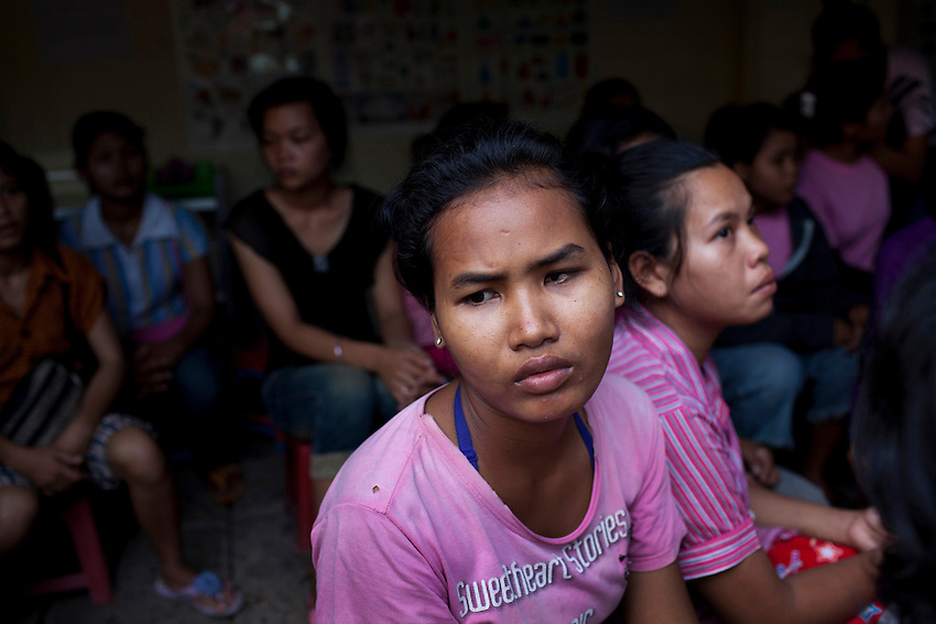Domestic migrant workers who say they want to go home instead of being sent to Malaysia are seen at an SKMM Investment Group training centre where they were being held against their will in Russey Keo district, Phnom Penh, October 19, 2011. The recruitment firm, which sends Cambodian maids to Malaysia for placement, was raided the following day. More than 70 women, including a number of underage girls, were freed from the company's three training centers in Phnom Penh. According to Cambodian law, domestic workers must be at least 21 years of age to travel to Malaysia to work as maids, however some of the recruits who were as young as 15 and 16 and stated that the company had falsified travel documents to bypass the rules.