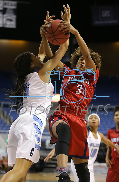 Centennial's Jade Thomas fights for the ball with Liberty's Journie Augmon during the NIAA state basketball tournament in Reno, Nev., on Friday, Feb. 23, 2018. Centennial won the title, 74-65 in overtime. Cathleen Allison/Las Vegas Review-Journal