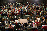 People listen to Senator Scott Brown (R-MA) speak in the American Civic Center in Wakefield, Massachusetts, USA, on Thurs., Nov. 2, 2012. Senator Scott Brown is seeking re-election to the Senate.  His opponent is Elizabeth Warren, a democrat.