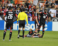 D.C. United defender Brandon McDonald (4) talks to the main referee Jose Carlos Rivero for the fouled to Maicon Santos (29) D.C. United defeated Chivas USA 1-0 at RFK Stadium, Sunday September 23, 2012.
