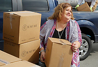 NWA Democrat-Gazette/DAVID GOTTSCHALK Lori Proud, director of the Springdale Senior Activity and Wellness Center, loads boxes of Pack Shack meals  Thursday, March 1, 2018 in front of the center in Springale. Tyson Foods donated 8,000 pounds of protein and 11,500 Pack Shack meals, to Meals on Wheels of Washington County. Meals on Wheels of Washington County delivers approximately 16,000 meals a month. Meals on Wheels of Washington County delivers approximately 16,000 meals a month. Tyson Foods team members recently volunteered to assemble the donated Pack Shack meals.