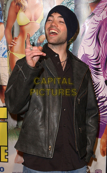 JOHN HENSLEY.The Big Bounce world premiere held at The Mann Village Theatre in Westwood, California.29 January 2004        .*UK Sales Only* .half length, half-length, funny, pointing, laughing                                                      .www.capitalpictures.com.sales@capitalpictures.com.©Capital Pictures.