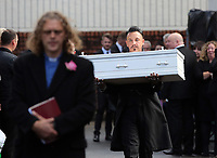 "COPY BY TOM BEDFORD<br /> Pictured: Paul Black carries the white coffin of his daughter Pearl after the service out of the Jerusalem Baptist Chapel in Merthyr Tydfil, Wales, UK. Friday 18 August 2017<br /> Re: The funeral of a toddler who died after a parked Range Rover's brakes failed and it hit a garden wall which fell on top of her will be held today at Jerusalem Baptist Chapel in Merthyr Tydfil.<br /> One year old Pearl Melody Black and her eight-month-old brother were taken to hospital after the incident in south Wales.<br /> Pearl's family, father Paul who is The Voice contestant and mum Gemma have said she was ""as bright as the stars""."