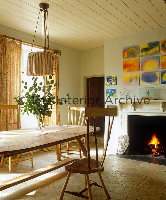 The oak kitchen table and greenwood ash chairs were made by Henry Brudenell-Bruce