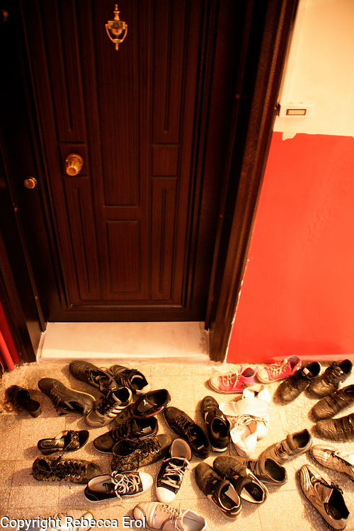 Visitors' shoes outside an apartment front door in Turkey