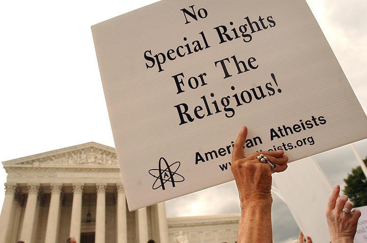 Maria Curry, a proponent of seperation of church and state, holds a sign in front of the Supreme Court.  She was there for the Supreme Court ruling on display of the Ten Commandments, in the states of Kentucky and Texas.