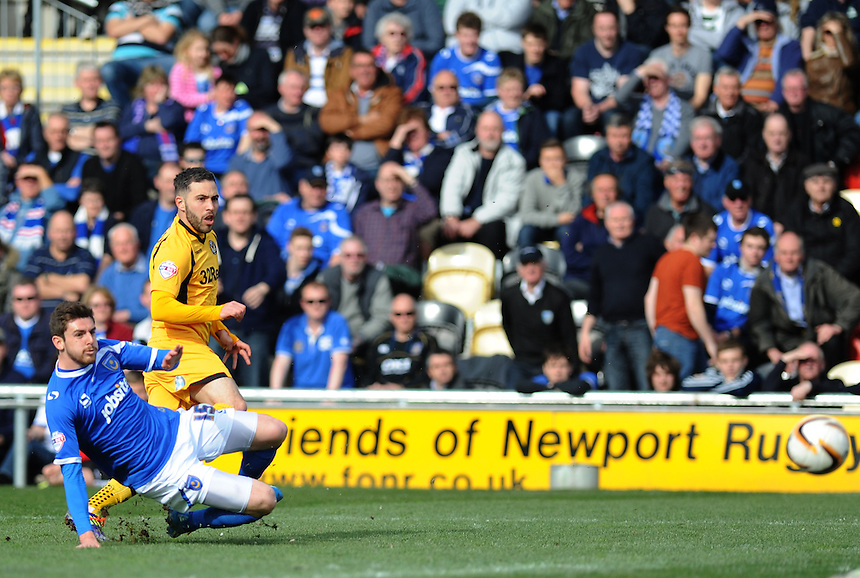 Newport County's Robbie Willmott has a shot on goal<br /> <br /> Photo by Ashley Crowden/CameraSport<br /> <br /> Football - The Football League Sky Bet League Two - Newport County AFC v Portsmouth - Saturday 29th March 2014 - Rodney Parade - Newport<br /> <br /> &copy; CameraSport - 43 Linden Ave. Countesthorpe. Leicester. England. LE8 5PG - Tel: +44 (0) 116 277 4147 - admin@camerasport.com - www.camerasport.com