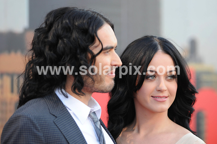 **ALL ROUND PICTURES FROM SOLARPIX.COM**                                             **WORLDWIDE SYNDICATION RIGHTS**                                                                                  Caption:  The UK premiere of Arthur.  Held at the O2 Arena, Greenwich Peninsula, London.                                                                              This pic: Russell Brand and Katy Perry                                                                                             JOB REF: 13176       SSD       DATE: 19.04.2011                                                           **MUST CREDIT SOLARPIX.COM OR DOUBLE FEE WILL BE CHARGED**                                                                      **MUST AGREE FEE BEFORE ONLINE USAGE**                               **CALL US ON: +34 952 811 768 or LOW RATE FROM UK 0844 617 7637**