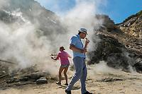 Pozzuoli, 19 Giugno, 2017. Due turisti mangiano salsicce cotte nel vapore della solfatara di Pozzuoli. L'intera area &egrave; considerata dagli esperti come una delle pi&ugrave; pericolose per quanto riguarda la possibile eruzione del vulcano sottostante.<br /> Antonello Nusca/Buenavista photo