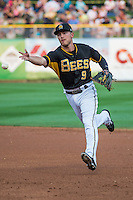 Alex Yarbrough (9) the second baseman of the Salt Lake Bees tosses the ball to first base on defense against the Iowa Cubs in Pacific Coast League action at Smith's Ballpark on August 21, 2015 in Salt Lake City, Utah. The Bees defeated the Cubs 12-8. (Stephen Smith/Four Seam Images)