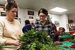 BETHLEHEM, CT. 06 December 2018-120618 - Sarah Leonard of Goshen, left, helps assist Shannon Carrizzo of Bethel with her wreath during the annual Wreath making social event at March Farms in Bethlehem on Thursday. Sue March the owner of March Farms says for everyone to sig up and get your spots early next year as they went very quickly this year. Bill Shettle Republican-American