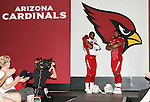 The Arizona Cardinals today unveiled their new uniforms for the 2005/2006 season.  Here defensive players Karlos Dansby and Darnell Dockett strike a pose on the runway.