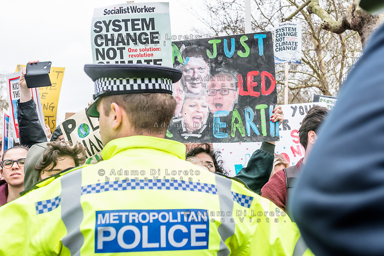 London, England on 15 March 2019: a police man take the protesters during the youth climate strike in London. The protest against climate change and urge the government to take action.The global movement has been inspired by teenage activist Greta Thunberg, who has been skipping school every Friday since August to protest outside the Swedish parliament. Photo Adamo Di Loreto/BunaVista*photo