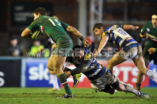 Gavin Henson tackles Blaine Scully. LV= Cup match, between Leicester Tigers and Bath Rugby on January 31, 2014 at Welford Road in Leicester, England. Photo by: Patrick Khachfe / Onside Images