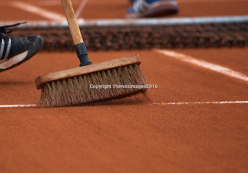 Paris, France, 28 June, 2016, Tennis, Roland Garros, court maintanance, net tweeping clay and broom tweeping the line.<br />
