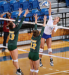 BROOKINGS, SD - SEPTEMBER 30:  Jenni Fassbender #13 and Emily Miron #12 from North Dakota State looks for the block on Emily Veldman #12 from South Dakota State in the second game of their match Tuesday night at Frost Arena in Brookings. (Photo/Dave Eggen/Inertia)