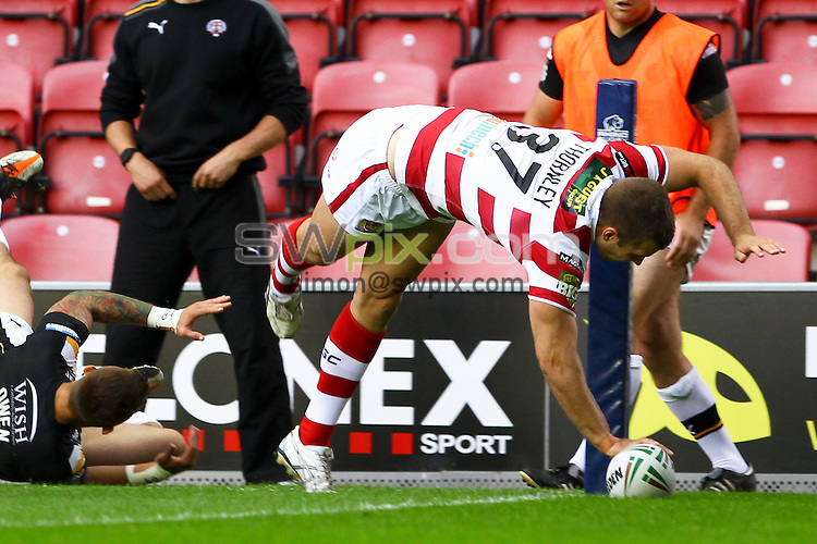 PICTURE BY ALEX WHITEHEAD/SWPIX.COM - Rugby League - Super League - Wigan Warriors v Castleford Tigers - DW Stadium, Wigan, England - 27/07/12 - Wigan's Ian Thornley scores a try.