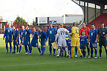 Bangor City 0 FC Honka 1, 23/07/2009. Racecourse Ground, Europa League. The players of Bangor City (blue) and FC Honka from Finland exchanging handshakes at Wrexham's Racecourse Ground, before the sides' Europa League second round second leg tie. The match had to be staged away from City's Farrar Road ground as it did not meet UEFA's stadium standards. The Finns won 1-0 in Wales to go through 3-0 on aggregate in front of 602 spectators in the first season of the newly-introduced competition which replaced the UEFA Cup. Photo by Colin McPherson.