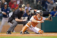 Texas Longhorns catcher Jeremy Montalbano #33 sets a target as home plate umpire Doug Williams looks on during the game against the Rice Owls at Minute Maid Park on February 28, 2014 in Houston, Texas.  The Longhorns defeated the Owls 2-0.  (Brian Westerholt/Four Seam Images)