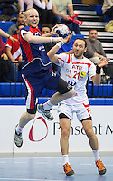 06 APR 2012 - LONDON, GBR - Great Britain's Sebastien Edgar (GBR) (left, in blue and red) shoots during the men's 2012 London Cup match against Tunisia at the National Sports Centre in Crystal Palace, Great Britain (PHOTO (C) 2012 NIGEL FARROW)