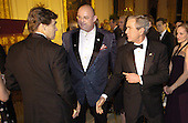 U.S. President George W. Bush (R) escorts Irish singer Ronan Tynan (C) past Texas Gov. Rick Perry after Tynan performed in the East Room of the White House for the entertainment portion of a State Dinner in honor of the nation's governors, February 25, 2007 in Washington. The National Governor's Association is holding it's annual Winter meetings in Washington.    POOL PHOTO by Mike Theiler/EPA