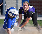 Freeburg baserunner Miranda Schulte (left) is safe at home plate as Breese Central pitcher Olivia Wesselmann tried to put the tag on her. Breese Central High School played at Freeburg High School on Tuesday May 1, 2018. Tim Vizer | Special to STLhighschoolsports.com