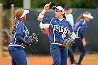 11 February 2012:  FIU's Jessy Alfonso (8) signals to Ashley McClain (2) during a break in the action as the University of Louisville Cardinals defeated the FIU Golden Panthers, 4-2, as part of the COMBAT Classic at the FIU Softball Complex in Miami, Florida.