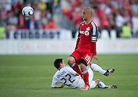 Toronto FC Toronto FC defender Mikael Yourassowsky #19 and Vancouver Whitecaps FC forward Shia Salinas #22 in action during an MLS game between the Vancouver Whitecaps and the Toronto FC at BMO Field in Toronto on June 29, 2011..